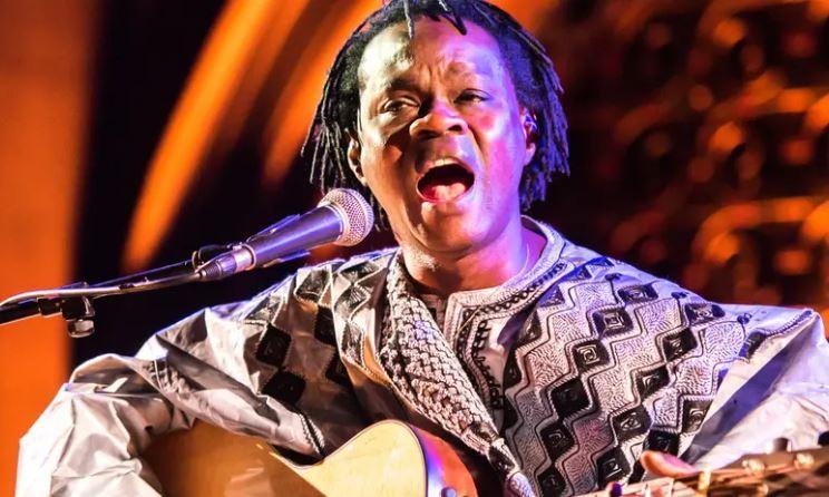 Baaba Maal playing Guitar